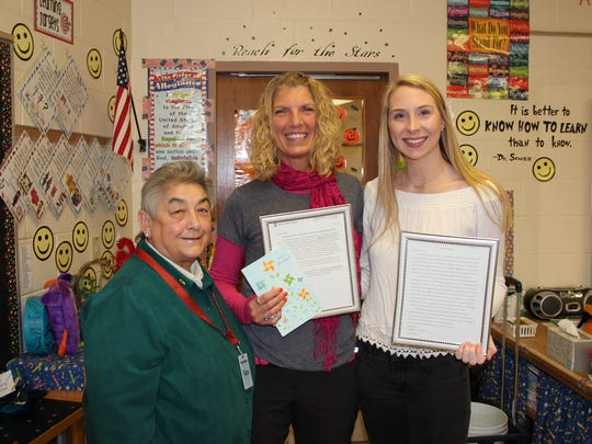 Stangel Elementary School teacher Susan Pritzl, center, received a surprise visit from a student she taught 13 years ago in second grade. Hailee Kotche of Manitowoc, right, a junior majoring in education at Silver Lake College, stopped to visit Pritzl's classroom on Nov. 1. She was accompanied by her current teacher, Chris Rettler, assistant professor of education at Silver Lake College. They presented Pritzl with framed letters of gratitude for inspiring Kotche to love reading and to pursue teaching.