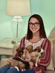 Tanner Hooten with her foster puppies.