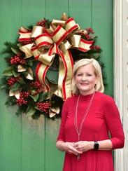 Patti Thomas previews her elegant wreath prior to the