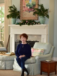 Lacy Sweeney previews her mantle decor before the St.