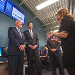 U.S. Sen. Patrick Leahy, center, and FBI Director James Comey, right, tour the Leahy Center for Digital Investigation with Champlain College Professor Jonathan Rajewski on Friday.