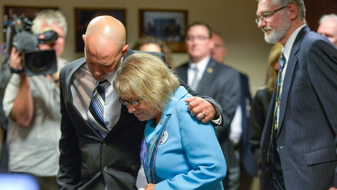 Trevor Wetterling comforts his mother, Patty Wetterling after she spoke Tuesday at a federal court press conference Tuesday in Minneapolis.