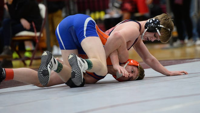 Mason's JD Greathouse, on top, defeats Josh McMann from Edwardsburg in the 140 weight class at the Division 2 individual regional tournament this season. Greathouse will attend Indiana University next season.