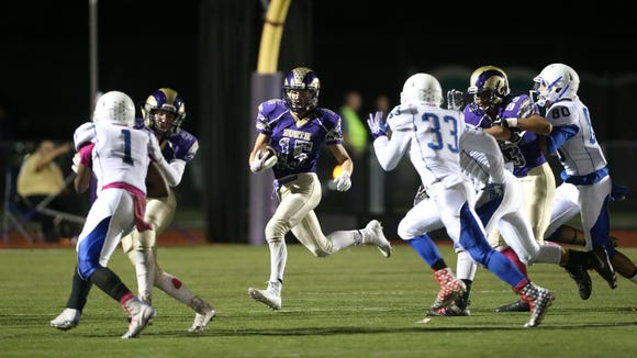 Clarkstown North's Joey O'Hara (15) looks for a hole during their 22-0 win over Port Chester 22-0 in the Class AA playoff qualifying game at Clarkstown North High School in New City on Friday, October 13, 2017.