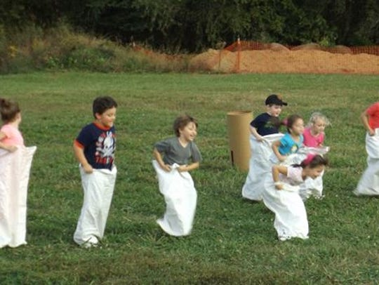 The sack race is part of the Kids Rodeo at Houston