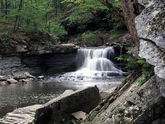 McCormick's Creek was Indiana's first state park, notable for its limestone canyon, flowing creek, and scenic waterfalls.