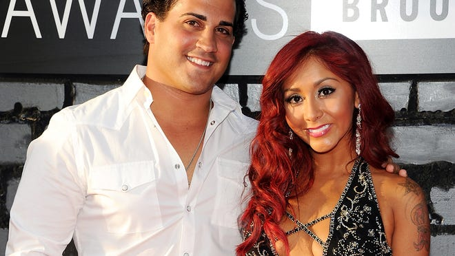 "FILE - In this Aug. 25, 2013 file photo, Nicole ""Snooki"" Polizzi, right, and Jionni LaValle arrive at the MTV Video Music Awards in the Brooklyn borough of New York. Snooki has officially tied the knot. Former ""Jersey Shore"" star Polizzi married boyfriend LaValle in a church ceremony Saturday, Nov. 29, 2014, in East Hanover, about 15 miles west of New York City. (Photo by Evan Agostini/Invision/AP, File)"