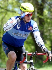 A marshall in the Police Unity Tour salutes as he and other cyclists pay their respects near the site where retired Roxbury Lt. Joseph Franklin was involved in a fatal cycling accident during the Police Unity Tour last year. May 9, 2017, Far Hills, NJ