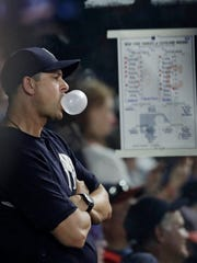 New York Yankees manager Aaron Boone watches in the seventh inning of the team's baseball game against the Cleveland Indians, Friday, July 13, 2018, in Cleveland.