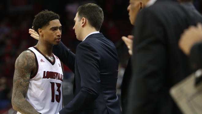 Louisville interim coach David Padgett has a word with junior forward Ray Spalding as Spalding leaves the game. March 20, 2018.