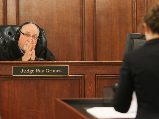 Judge Ray Grimes listens as Clinton Hunter III's attorney,