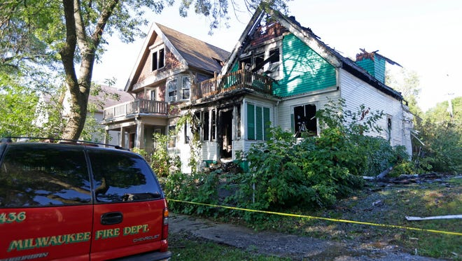 A two-alarm fire on Milwaukee's west side engulfed two homes early Thursday.