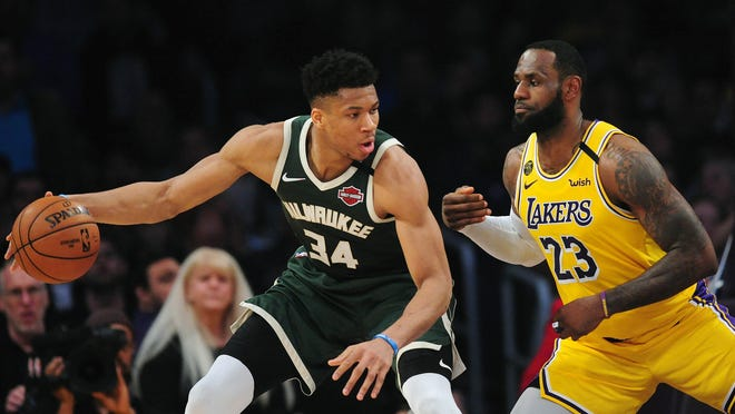 Milwaukee Bucks forward Giannis Antetokounmpo (34) controls the ball against Los Angeles Lakers forward LeBron James (23) during the first half at Staples Center on March 6, 2020.