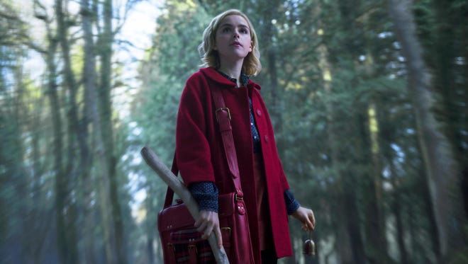 "This image released by Netflix shows Kiernan Shipka in a scene from ""Chilling Adventures of Sabrina,"" premiering on Oct. 26."