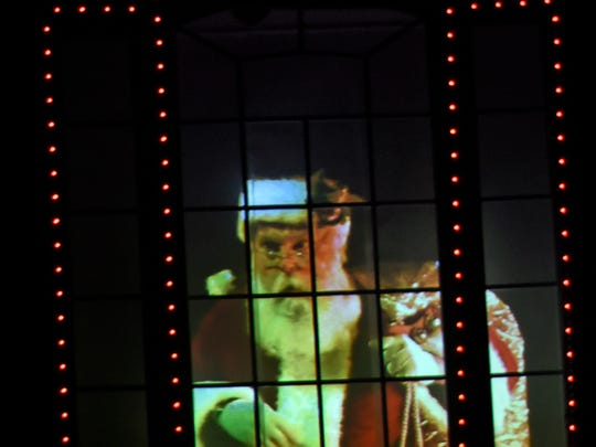 A home at 1716 Bell Avenue, Chambersburg, is decorated with a light show in Chambersburg. Pictured is Santa in the window.
