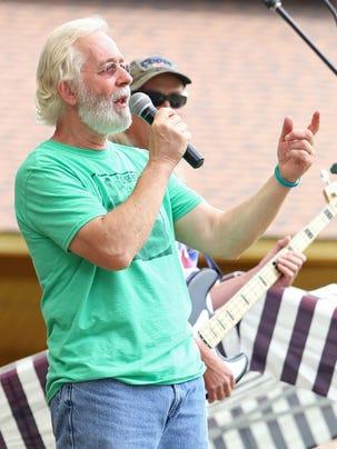 Groovefest founder Tim Cretsinger speaks during the