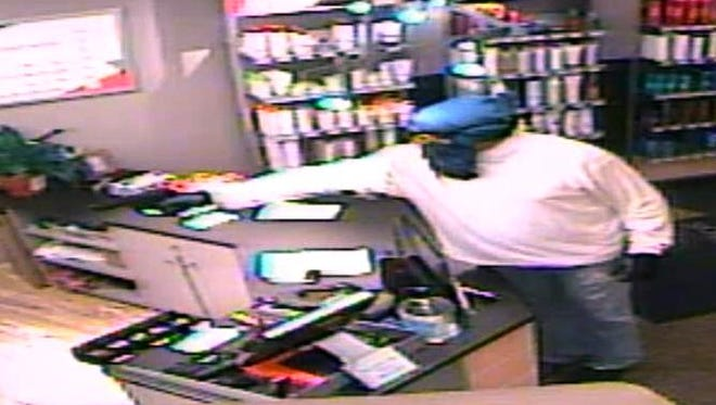 A second image of the suspect at the scene of Monday's Great Clips robbery.