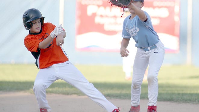QuinlanAgency.com shortstop Chase Chamberlain tags the base for the force while Rt. B Cafe's Aiden Meyers attempts to get back to the base in the fifth inning last Thursday in Cal Ripken Major at the Cooper County Baseball Association Ballfield.