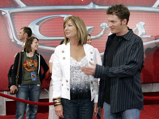 "In this May 2006 photo, NASCAR driver Dale Earnhardt Jr., right, and his mother Brenda Jackson, front left, arrive for the premiere of the Disney/Pixar animated film ""Cars"" at Lowe's Motor Speedway in Concord, N.C. Jackson, a longtime employee at JR Motorsports, has died following a battle with cancer. She was 65."