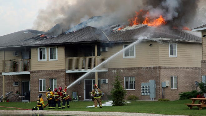 Firefighters battle an apartment fire on Happy Lane in Sheboygan Falls on Wednesday, Aug. 10, 2016.
