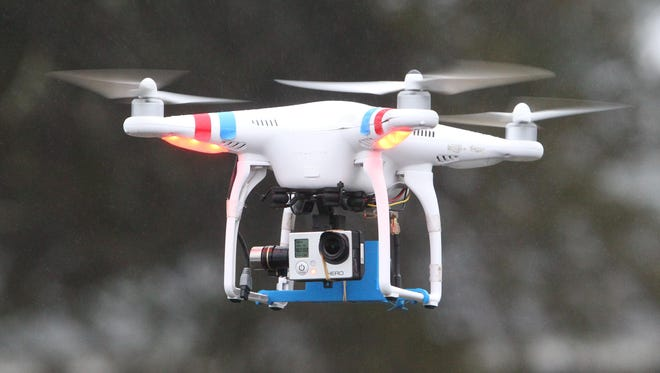 Vinny Garrison of FlyingFilmsNY flies a quadcopter drone at the Outdoor Education Center in Nanuet in December 2014.