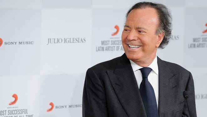 Latin pop icon Julio Iglesias poses for photographers at a news conference where he was named the 'Most Successful Latin Artist of All Time',  at a central London venue on May 12, 2014.