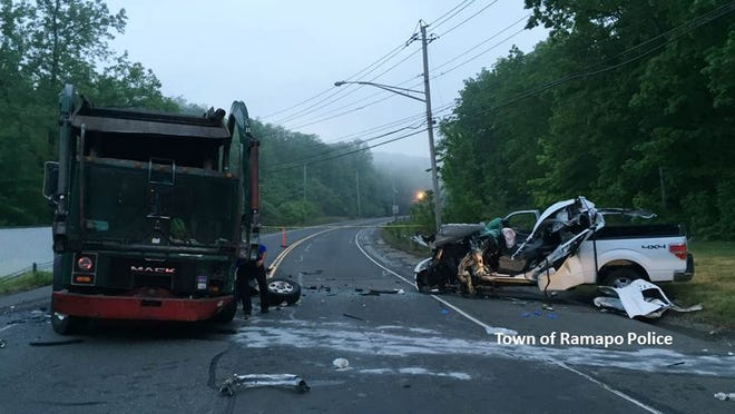 The wreckage from Monday morning's head-on crash between a garbage truck and a pick-up on Sterling Mine Road in Sloatsburg. The pick-up driver, Stefan Connolly of Orange County, died.