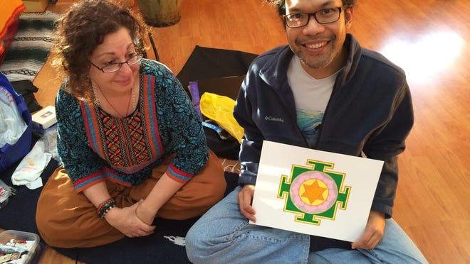 Mavis Gewant admires Joel Ying's Lakshmi Yantra created at Love Yoga, Naples.