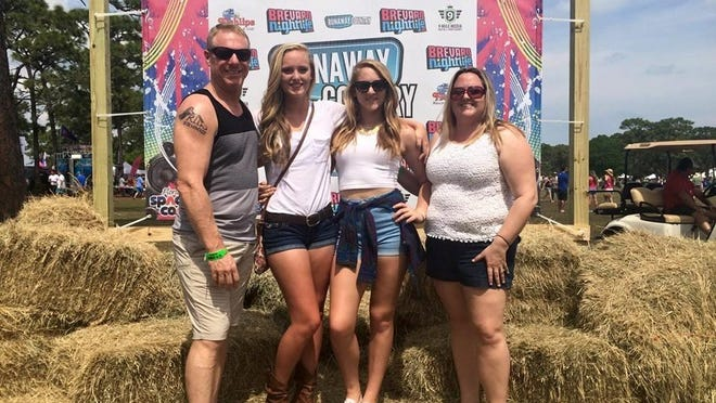 Michael, Lacey (16), Riley (14), and Michelle Higgins at last years' Runaway Country Music Festival.