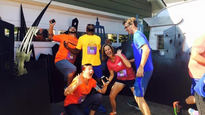 """Runners Andrew Holbert, Michael Turner, Kelly Grace and Scott and Jeanine Stice pose for a quick photo op at a stop during """"Bridging the Gap Salem Leadership Foundation 10K."""""""