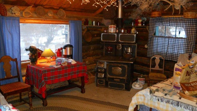 Guests can warm up inside the cabin with hot cocoa and marshmallows during Tizer Gardens' events Nov. 22 through Christmas.