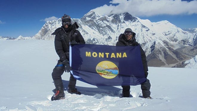 Above: Kent Lockman and Ben Darce unfurled a Montana flag when they reached the Summit of Ama Dablam in Nepal. Top: With tent space tight at Camp 2, Ben Darce and Kent Lockman endured a night at 20,000 feet each in an open-air bivy.