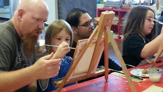 Families paint at Young at Art.