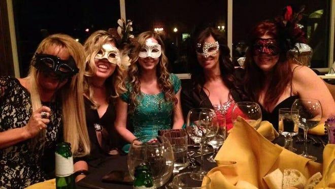 Masks at masquerade ball in 2014.