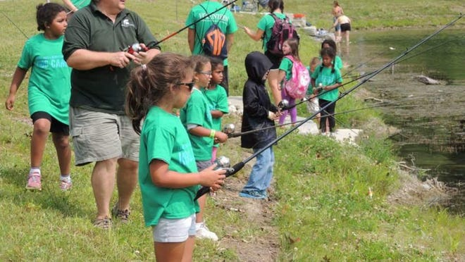 MSU project FISH administrator Mark Stephens coordinates programs that teach children conservation. He is the recipient of Michigan United Conservation Clubs' 2016 Conservation Educator of the Year award.