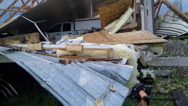 Strong spring storms ripped through Fergus County on Friday, carrying large hail and winds as high as 90 miles per hour. Three men survived the destruction of this shop in Roy by hiding beneath the pickup shown covered in debris.