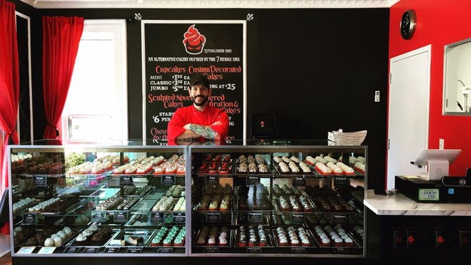 Owner Ryan Swift standing behind the counter at Sinful Sweets on Alexander Street (Photo: Provided)