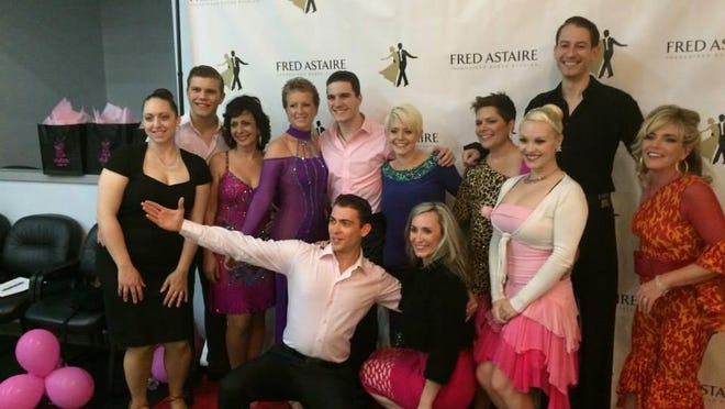Dancers and their partners at the 2014 Dancing With the Survivors event at Beyer Ford in Morristown.