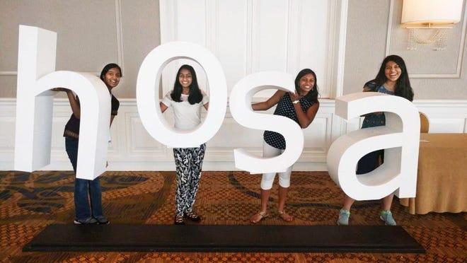 (From left) Harrison High School students Veena Thamilselvan, Yashasvni Nannapuraju, Likitha Nimmagadda and Riya Shah.
