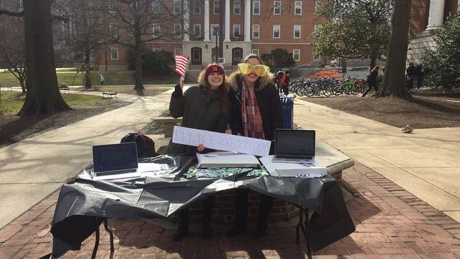 A photo of the author's team tabling on campus to raise awareness of the national debt.