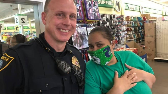 Ardmore Police Department Sgt. Brice Woolly helps distribute masks to essential employees as a part of an initiative taken by Heroes with Hope. The nonprofit has been crafting reusable masks for essential employees around Carter County.