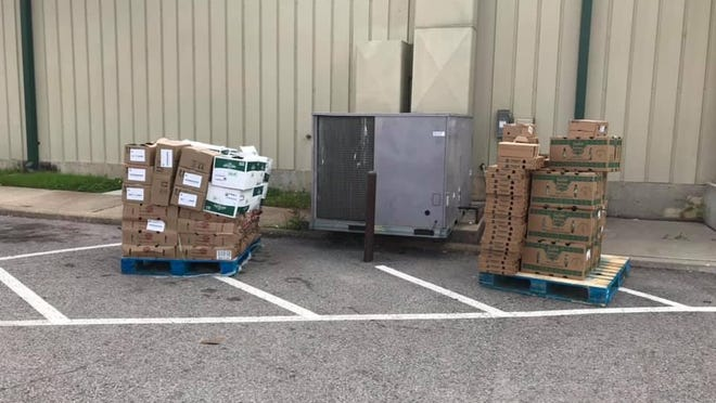 Extra pallets of food sit outside the Food and Resource Center of South Central Oklahoma for anyone to come take as they need. The center has been receiving additional pallets of produce during the pandemic and have also given additional food to area nonprofits and organizations.