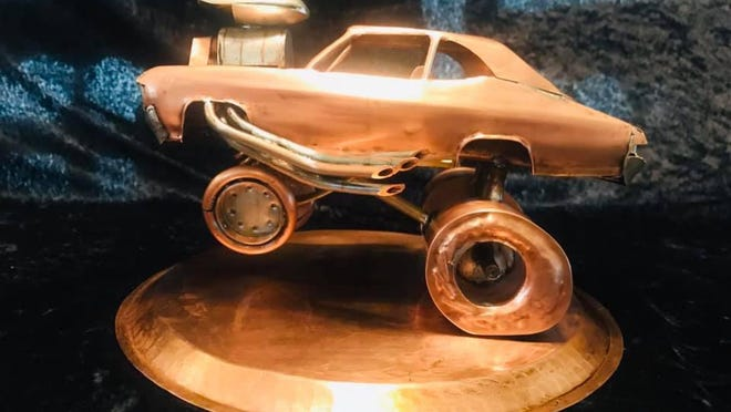 This hot rod style sculpture iss totally constructed from copper. The silver or chrome parts are also copper but tined with solder. The blower was made from two silver spoons.