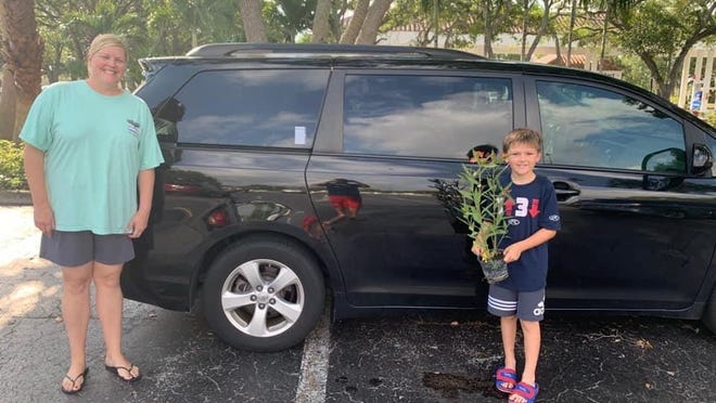 Allamanda Elementary second-grade teacher Melissa Vonderhaar poses with student Caycen Spagnulo recently after Caycen picked up a caterpillar/butterfly-attracting milkweed plant donated by MSA Nursery for an upcoming life-cycle science unit.