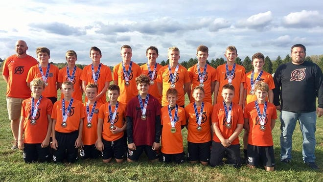 Members of the Ashland United Soccer Club's U15 boys travel team pose for a picture after winning the Division I bracket at the Ohio Travel Cup Tournament in October. Several of the youth organization's teams recently resumed practices after their indoor and spring seasons were canceled due to the coronavirus outbreak.