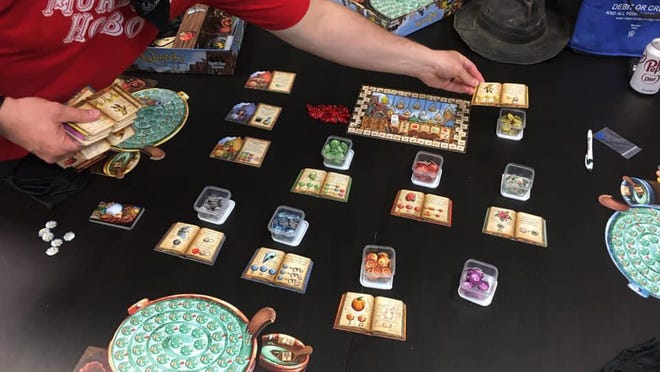 Players have come back to the open game nights at Game Cafe on the Independence Square since the business reopened with limited capacity for customers and players.