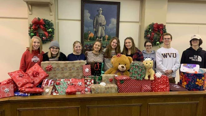 Members of the Stow Youth Commission raised money for gifts and gift cards to help families in Stow during the holiday season. They are now planning to help senior citizens with yard work and errands.