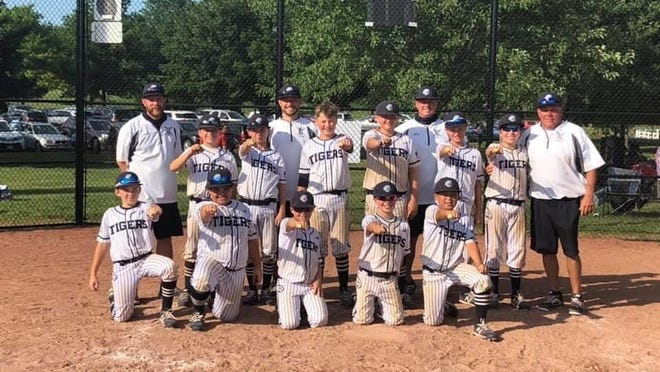 The Twinsburg Tigers' age 11-and-younger travel baseball team won the United States Specialty Sports Association AAA state title Sunday in Jackson Township. Pictured are, front row, from left: Sean McHugh, Adam Horne, Cooper Goodman, AJ Sorace and Aiden Shinada; middle row: Teddy Goodman, Braden Holdford, Kyler Hoon, Nathan Kimmel, Dylan Fantone and Nate Luca; and back row: head coach is Mike Holdford and assistant coaches Mason Goodman, Adam Hoon and Jeff Luca.