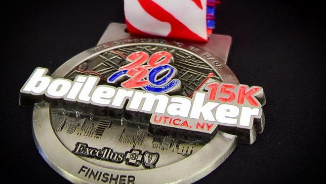 Participants of the 2020 Boilermaker Road Race 15K will be shipped a finishers medal (pictured), commemorative pint glass and race bib. Participants in the 5K will get a finishers pin.