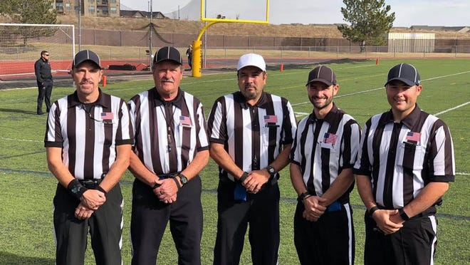 Member of the Pueblo Football Officials Association (left to right) Mike Gage, Kolby Davidson, John Madrid, Gary Strubel and Bill Moorman prepare to work a playoff game last season.